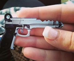 Instead of a plain and simple house key, get yourself one of these awesome gun keys! It's the perfect way to tell your keys apart and features a print of a 45 caliber handgun. Great to use as your main house key.