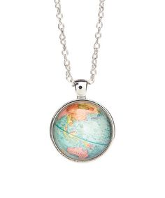 A globe pendant lends worldly appeal to this necklace.
