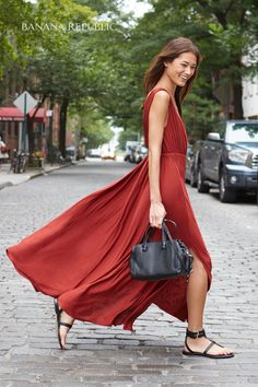 """The """"Wow"""" factor in a V-neck brick red maxi dress with deep side slits. The perfect wedding guest dress, destination or local. Easy to pack, impossibly comfortable. Wow."""
