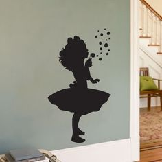 Wall Decal,  make from own photo, enlarged with copying machine, cut out in black self adhesive vinyl. Or project on wall and draw outlines, paint.