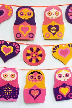 Day of the Dead garland featuring Sugar Skull Matryoshkas. Free printable by happythought.co.uk