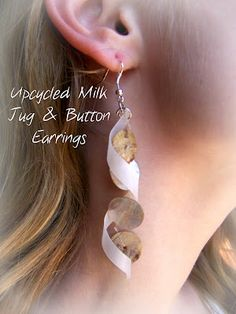 Make these cute earrings from empty milk jugs and old buttons!  How to make cool jewelry from recycled plastic....