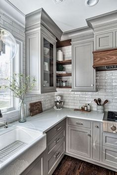 Inspiring Grey Kitchen Design Ideas Grey kitchens will never go out of style. These photos of kitchens with gray cabinets will inspire you to embrace this trendy neutral. We're going over painted gray cabinets, farmhouse grey kitchens, dark gray k Farmhouse Kitchen Cabinets, Kitchen Cabinet Design, Interior Design Kitchen, Diy Kitchen, Stylish Kitchen, Kitchen Ideas With Grey Cabinets, Kitchen Layout, White Cabinets, Kitchens With Color