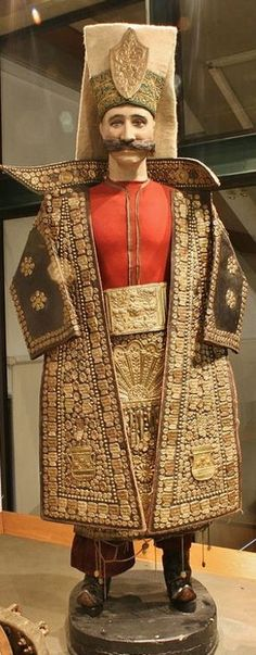 18th century ceremonial Ottoman military uniform of an Janissary officer, in charge of the daily distribution of the soup.  Embroidered leather, with inlaid metal ornaments. This was a high position in the Ottoman army (after all: the love of the man goes through the stomach...).  Note that all uprising of the Janissary corps began with knocking over the large soup kettles used for the food distribution.