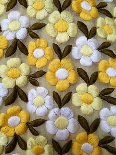Detail of floral embroidery on 1960s dress.