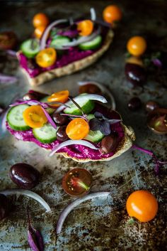 Toast with Beet Hummus, cucumbers, tomatoes and olives