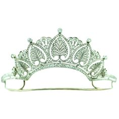 A rare art deco diamond palmette tiara, circa 1930s. Featuring five honeysuckle palmette motifs, each topped with a large circular diamond; with triple diamon sprays as spacers, and supported by a band of circular diamonds.