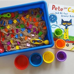 Button Sensory Bin Hide some buttons in a sensory bin & let them find & sort the colors. We used kinetic sand but you could use rice or… Sensory Tubs, Sensory Activities Toddlers, Sensory Rooms, Pre K Activities, Montessori Activities, Sensory Play, Toddler Sensory Bins, Sensory Diet, Pete The Cat Buttons