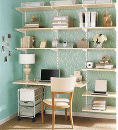 Lovely fresh looking home office, I love the aqua wall paper with white and sand furniture. elfa® Office Sand & White