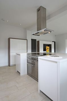 Combined with clean and minimal styling this Mercury range cooker, in stainless steel finish, is used to create a bold central feature in this ultra modern setting.