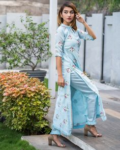 Powder blue embroidered kurta with pants - set of two by the weave story the secret label. Salwar Designs, Simple Kurti Designs, Kurti Neck Designs, Dress Neck Designs, Kurta Designs Women, Kurti Designs Party Wear, Sleeve Designs, Blouse Designs, Neck Designs For Suits