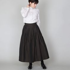 """[Envelope online shop] Marianne Lisette Formalwear  ・  Wide skirt made with plain colour woven linen. We made a lot of pleads around the waist. Tea(Mole) and Ink black colour options available.  There is hidden zip at the back and pockets on both sides.  The simple design that makes it a popular item for this autumn/winter,  as it is easy to match with different style tops.  For formal occasions, you can wear as a set with same fabric jacket """"Electra"""".  #lisette #skirt"""