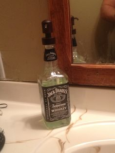 Everyone's seen the alcohol bottle soap dispensers.. Well guys, face it. You gotta have some bathroom hand soap. So grab your bottle, take the cap off (this is what you go to the store with), and clean it. Then go to the store and find a soap dispenser that your cap fits on. That ensures it'll fit on your bottle. Keep in mind how tall your bottle is, you may have to buy another one to extend the tube-I did. Then put the tubes together and throw it on your bottle. Boom. Manly soap dispenser DIY.