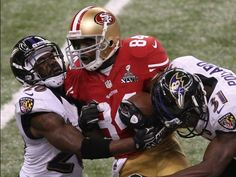 49ers receiver Randy Moss, center, gets sanwiched between Ravens defenders Ed Reed, left, and Bernard Pollard after a second-half catch. Crystal LoGiudice, USA TODAY Sports. Monday pre- 12pm