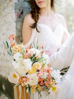 I think adding in some color to the bouquet is necessary since we'll be doing more neutrals for the tablescape and the scenery itself is very blue and neutral as well. Maybe not as much peach because that is summer looking.