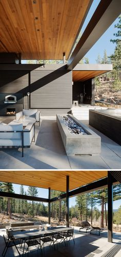 On the patio of this modern house, there's a long rectangular concrete firepit, a large metal table for dining, and two white upholstered sofa chairs, providing plenty of seating while eating dinner or using the outdoor pizza oven. A glass sliding wall can be used to separate this space from the kitchen inside.