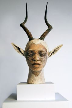 2011 Kate Clark, Title: Untitled (female bust).   Antelope hide, antlers, clay, pins, thread, rubber eyes, wood.  33 x 16 x 16 inches