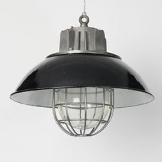 Stylish industrial downlighters removed from a communist-era factory in the Czech Republic. Unfortunately we haven't been able to source any further quantities of this desirable light.