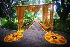 yellow - orange genda flowers  entrance, genda flower rangoli, sangeet function , day function , mehendi function , sunny bright colourful setting