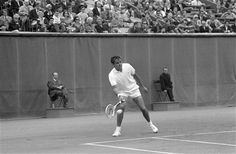 Pancho Gonzales of the U.S. in action against Rod Laver of Australia in the French International Open Tennis championships at Roland Garros stadium in Paris on June 7, 1968. (AP Photo/Eustache Cardenas)