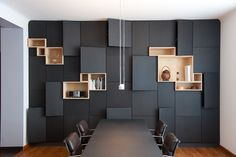 Asymmetrical pop-out full-wall cabinets and box-shelving