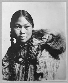 Eskimo mother with child on back, ca1906