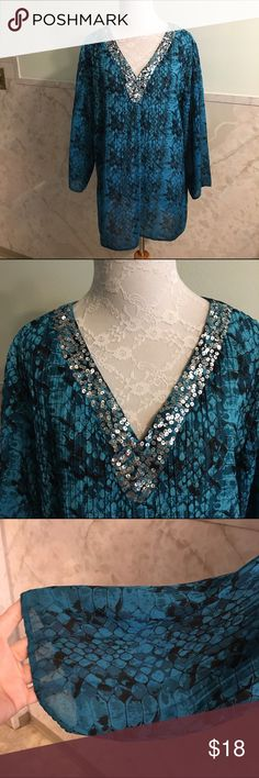 Fashion Bug Semi-Sheer Sequin Neckline Blouse The colors of this blouse are so rich against the silver sequins. They look great together. The blouse is a non-stretch and semi-sheer polyester. This is a nice and blousy top. Perfect with leggings. The color is a blue green. Fashion Bug Tops Blouses