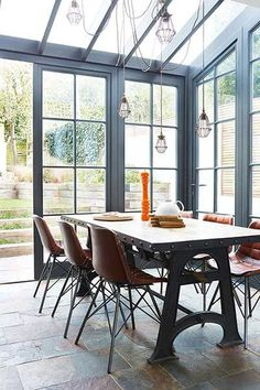 Beautiful paints conservatory and industrial table and chairs. Inspiration for kitchen side return extension and remodel
