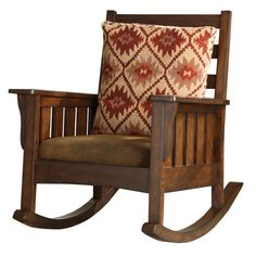 """I love the look of this rocking chair.  I feel like every home needs a rocking chair (or two!)  Solid hardwood rocking chair in dark oak with chocolate microfiber upholstery.     Product: Rocking chair and pillow    Construction Material: Wood frame and microfiber upholstery   Color: Chocolate and dark oak   Features:     Slats arms and legs  Deep cushioned seat  Dimensions: 41"""" H x 33"""" W x 41.75"""" D"""