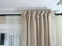 CLEVER use of off the rack Ikea tab top curtains, transformed easily to a non-tab top style.