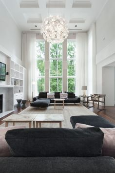 Pure elegance prevails in this living room designed by Gestion René Desjardins - we just love the Luceplan Hope Suspension Light! http://www.nest.co.uk/product/luceplan-hope-suspension-light Image via Designed for Life.