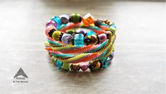 Colorful heringbone bracelet on memory wire, created by Annie & The Beads