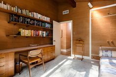 This mid century in Toronto by Gardiner Cowan has a post and beam structure that demands some attention. Douglas Fir creates this artistic arrangement