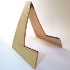 Simple, attractive and sturdy. This handmade wooden guitar stand is a great way…
