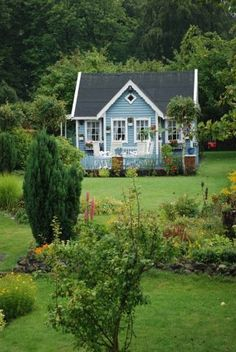 Sweet blue cottage ~ I wonder who lives here?