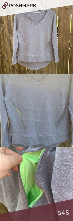 """Lululemon Athletica gray vneck zip pocket pullover Excellent condition, size 4, Lululemon Athletica gray v-neck pullover with front zip pockets. Cute neon green accent in pockets. Missing tear away size tag. Size dot in inner pocket. Measures approximately: 23"""" long in front, 26.5"""" long in back, 18.5"""" across pit to pit across chest. Feel free to ask any questions. lululemon athletica Tops Sweatshirts & Hoodies Neon Green, Green And Grey, Gray, Plus Fashion, Fashion Tips, Fashion Trends, Room Rugs, Asana, Hoodies"""