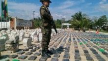 A Colombian police officer standing guard over seized cocaine in Turbo, Colombia, on May 15, 2016