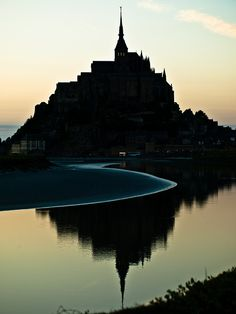The tidal waters surrounding Mont Saint-Michel, France This is one of my favorite places that I have ever visited and I cannot wait to return Places Around The World, Oh The Places You'll Go, Great Places, Places To Travel, Places To Visit, Around The Worlds, Mont Saint Michel France, Le Mont St Michel, Beautiful World