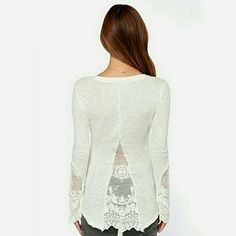 White Lace Blouse This is a must have for spring! Adorable lace detail on back and sleeves, henley front. Great fit, true to size! Tops Blouses