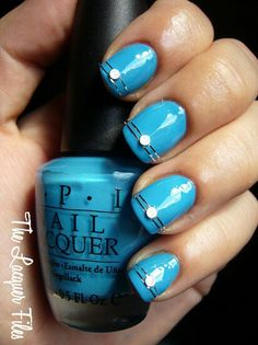 Blue nails with stripes and rhinestones