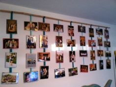 Bamboo stick from Lowes + Ribbon = the perfect photo display