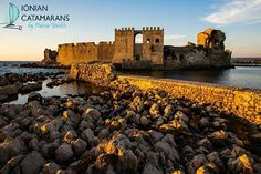 The castle of Methoni - one of the most distinctive castle-communities in Greece. It was built in 1209 by the Venetians on a rock that protrudes into the sea and is separated from the mainland by an artificial moat. Patras, Greece Culture, Medieval Castle, Catamaran, Greece Travel, Countries Of The World, Vacation Trips, Where To Go, Athens