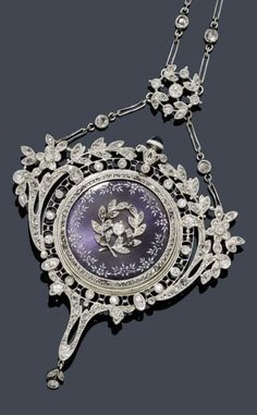 A BELLE ÉPOQUE DIAMOND AND ENAMEL NECKLACE WITH WATCH, probably HENRI BERTOUD, ca. 1910.  set with numerous diamonds, the centre set with one engine-turned and blue enamelled watch with appliquéd laurel leaf motifs and diamonds.