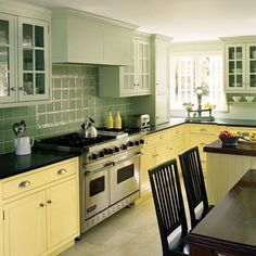 brightly colored kitchen with butter yellow cabinets