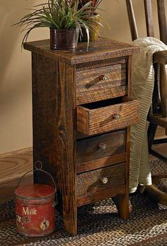 Entirely hand-crafted of reclaimed pine heartwood from historic cotton mills with unique shotgun shell drawer pulls.