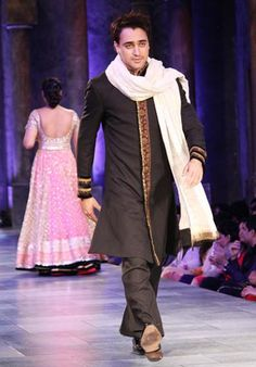 This Kashmir-inspired embroidered black kurta with ivory dupatta is classic Manish Malhotra style.