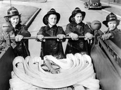 To meet the labor shortage during World War II, and free men for work war and the military, the Army trained these women to be firefighters. April 1, 1944.