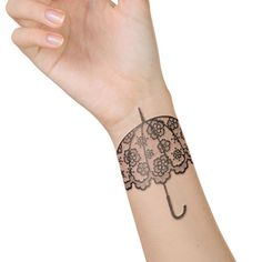 Lace umbrella tattoo on wrist