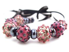 I see a lot of pink bead sets, but I love these! I'm not sure what it is about them, maybe that there's no floral elements, or that I'm a dot ho, who knows, but I likey! By SuzanneJewellery on Etsy!