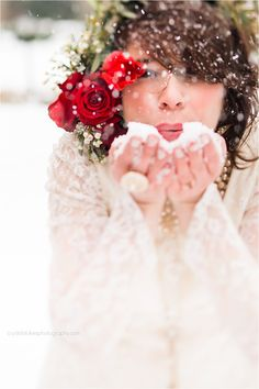 Snowy wedding shoot, snow photos, winter wedding, valentines, mothers wedding dress, blowing snow, red bouquet, vintage lace, vintage wedding gown, www.crystalstokesphotography.com
